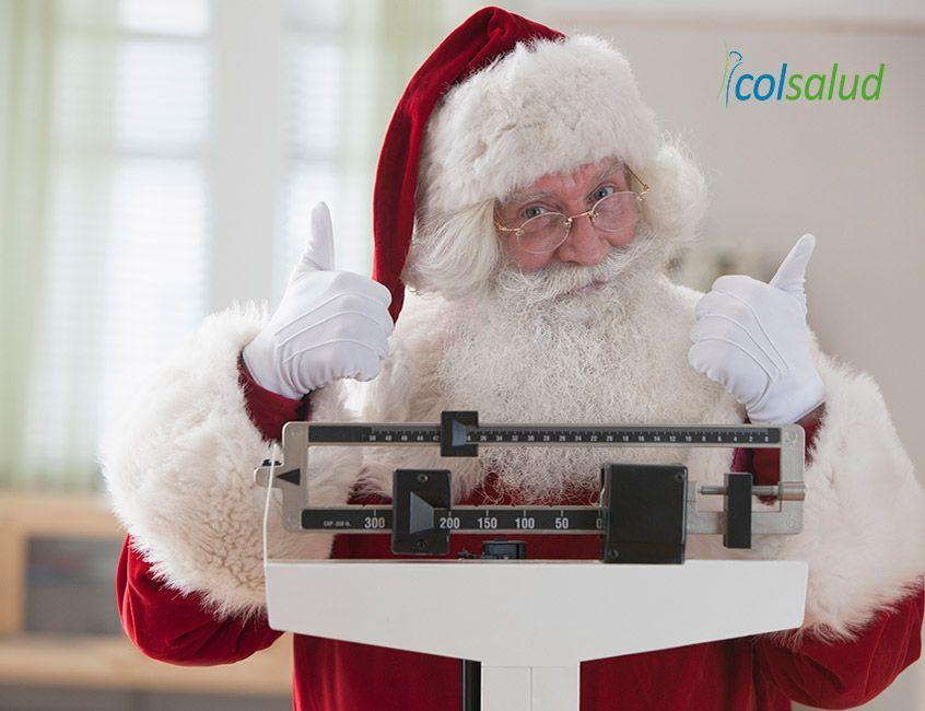 recomendaciones para evitar subir de peso durante fin de año - Santa pesandose